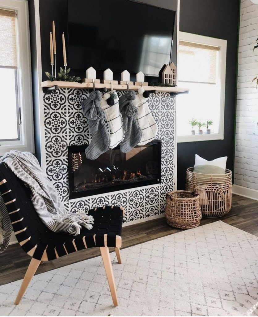 monochrome interior design for christmas 2020 with risom lounge chair, rattan baskets, inserted fireplace and faded distressed area rug - padstyle.com
