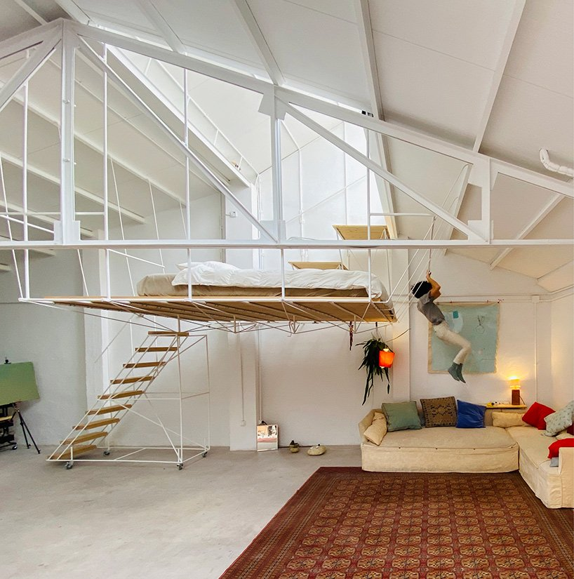 pía mendaro-designed artist's studio in madrid has a bed suspended from its ceiling